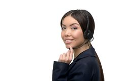 Asian call center female operator smiling Royalty Free Stock Photography