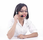 Asian call centre employee. A pretty asian call centre employee royalty free stock image