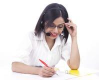 Asian call centre girl. A pretty asian call centre girl of indian origin Stock Photo