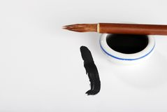 Asian calligraphy brush on ink pot Stock Photography