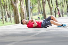 People with a heart attack. Asian cardiac arrest running young man heart attack in park.Severe heartache Royalty Free Stock Image