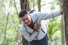 People with a heart attack. Asian cardiac arrest running young man heart attack in park.Severe heartache Royalty Free Stock Photos
