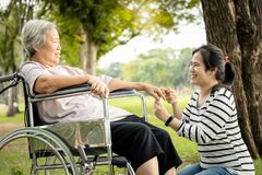 Free Asian Care Assistant Or Daughter Is Massaging Palm And Fingers Of Senior Mother Feel Numb,elderly Woman Having Injured Hands Royalty Free Stock Photography - 168777417