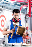 Asian Carpenter in wood workshop working Royalty Free Stock Image