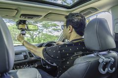 Asian casual man sit in car and sitting car camera ,safety first Stock Image