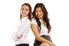 Asian and Caucasian business women Royalty Free Stock Photos