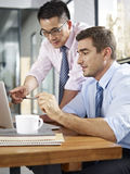 Asian and caucasian businessmen working together in office Royalty Free Stock Photo