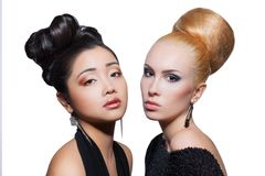 Asian and caucasian fashion models posing against Stock Images