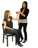 Asian And Caucasian Girls Toasting Stock Photography