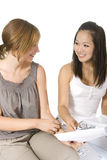 Asian and caucasian students girls. Asian and Caucasian student girls are studying Stock Photos