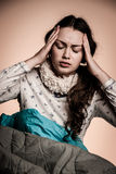 Asian caucasian woman having a head ache - girl with pain in hea Stock Images