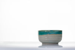 Asian ceramics cups on white with reflection Royalty Free Stock Photos