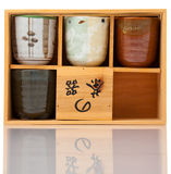 Asian ceramics tea cups set in wood case Stock Image