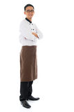 Asian chef arms crossed Asian chef arms crossed. Full body portrait of confident Asian chef arms crossed, smiling and standing isolated on white background Stock Image