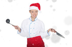 Asian chef in christmas cap with container under snow Royalty Free Stock Images