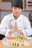 Asian chef cook welcomes guests Royalty Free Stock Image