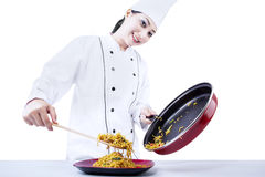 Chef cook fried noodle. Asian chef cooks fried noodle on white background stock photo