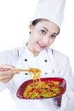 Asian chef and fried noodle - isolated Stock Images