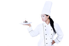 Confident chef and dessert Royalty Free Stock Images