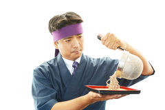 Asian chef with noodle. Portrait of an Asian chef in uniform Stock Images