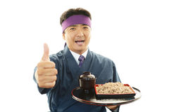 Asian chef with noodle. Portrait of an Asian chef in uniform Royalty Free Stock Image