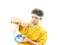 Asian chef with noodle. Portrait of an Asian chef in uniform Stock Photos
