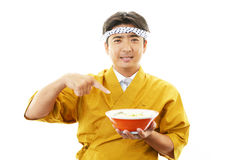 Asian chef with noodle. Portrait of an Asian chef in uniform Royalty Free Stock Photography