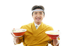 Asian chef with noodle. Portrait of an Asian chef in uniform Royalty Free Stock Photos