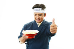 Asian chef with noodle. Portrait of an Asian chef in uniform Stock Image