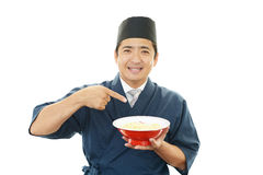 Asian chef with noodle. Portrait of an Asian chef in uniform Stock Photo