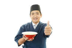 Asian chef with noodle. Portrait of an Asian chef in uniform Royalty Free Stock Images