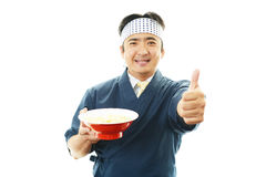 Asian chef with noodle. Portrait of an Asian chef in uniform Stock Photography
