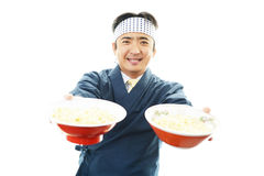 Asian chef with noodle. Portrait of an Asian chef in uniform Royalty Free Stock Photo