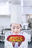 Asian chef serve noodle in kitchen Royalty Free Stock Photography