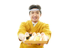 Asian chef with Sushi. Portrait of an Asian chef in uniform Stock Images