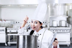 Asian chef tasting food Stock Photos