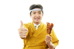 Asian chef with Yakitori. Portrait of an Asian chef in uniform Royalty Free Stock Photo