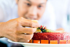 Asian chefs cooking in Restaurant Stock Photography
