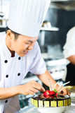 Asian chefs cooking in Restaurant Royalty Free Stock Photos