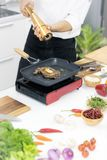 Asian chefs are striving to cook the most delicious cuisine in t royalty free stock photography