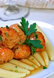 Asian Chicken Meatball over Baby Corn royalty free stock image