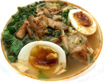 Asian chicken noodle soup. Asian noodle soup with boiled eggs, vermicelli, chicken, kale and fried onions Stock Photos