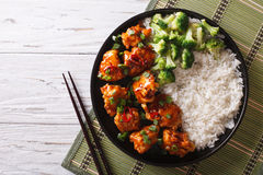 Asian chicken with rice, onions and broccoli. Horizontal top vie Royalty Free Stock Photography