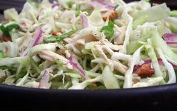 Asian Chicken Salad. Close Up of Asian Chicken Salad in Wood Bowl Stock Image