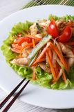 Asian chicken salad with roasted vegetables, vertical Royalty Free Stock Images