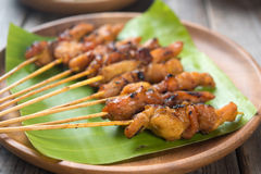 Asian chicken satay. Close up Malaysian chicken satay on wooden dining table, one of famous local dishes royalty free stock images