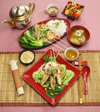 Asian Chicken Skewers. Full table setting of Asian chicken skewers with short soup and vegetables royalty free stock photos