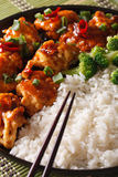 Asian Chicken tso with rice and broccoli close-up. vertical Royalty Free Stock Photos