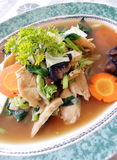 Asian chicken & vegetables dish. A dish of ethnic asian cuisine, Cap Cay, with slices of chicken and vegetables stir fried. Vegetables include carrots Stock Photo