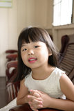 Asian child. Portrait of little Asian girl in white gown dress Stock Photography
